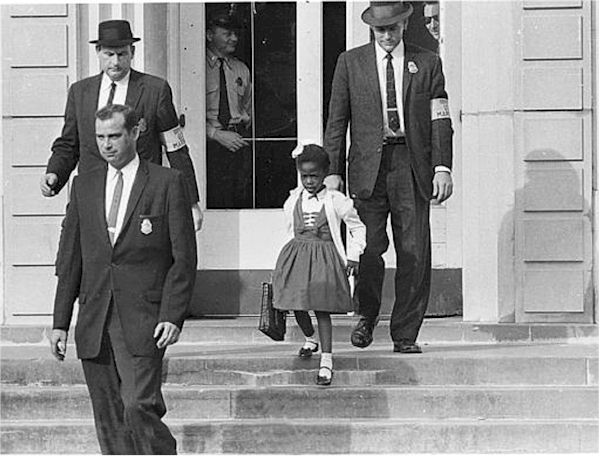 US Marshals with Ruby Bridges on the steps of William Frantz Elementary School in New Orleans (Nov. 14, 1960)