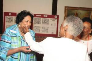 Mary Louise (left) shares laughs with friends at 65th class reunion