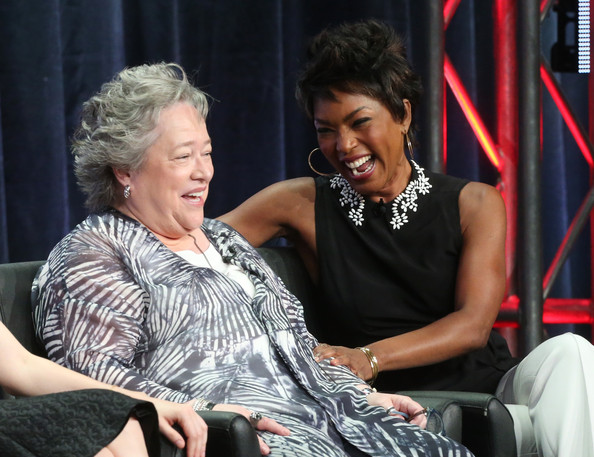 "(L-R) Actresses Kathy Bates and Angela Bassett speak onstage during the ""American Horror Story: Coven"" panel discussion at the FX portion of the 2013 Summer Television Critics Association tour - Day 10 at The Beverly Hilton Hotel on August 2, 2013 in Beverly Hills"