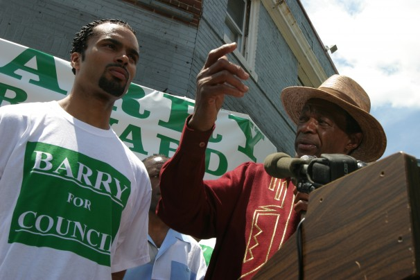Marion Christopher Barry, left, at his father's 2004 campaign announcement for DC Council