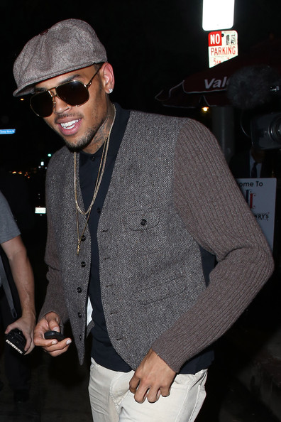 Chris Brown leaves the Hooray Henry's night club in West Hollywood. (August 15, 2013)