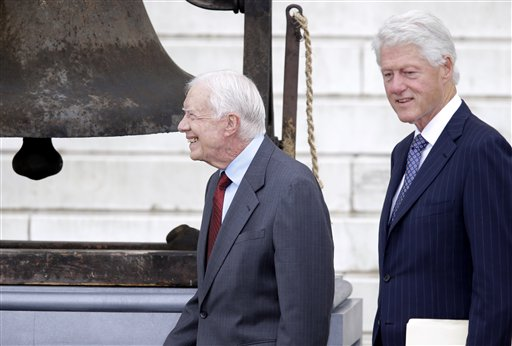 Former Presidents Jimmy Carter and Bill Clinton arrive at the Let Freedom Ring ceremony at the Lincoln Memorial in Washington, Wednesday, Aug. 28, 2013, to commemorate the 50th anniversary of the 1963 March on Washington for Jobs and Freedom.