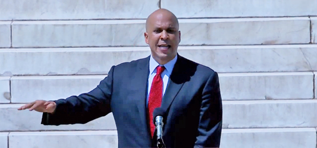 "Cory Booker speaks at the Lincoln Memorial during the National Action Network's ""Action to Realize the Dream March and Rally - Jobs, Justice & Freedom"" on Aug. 24, 2013 in Washington DC"