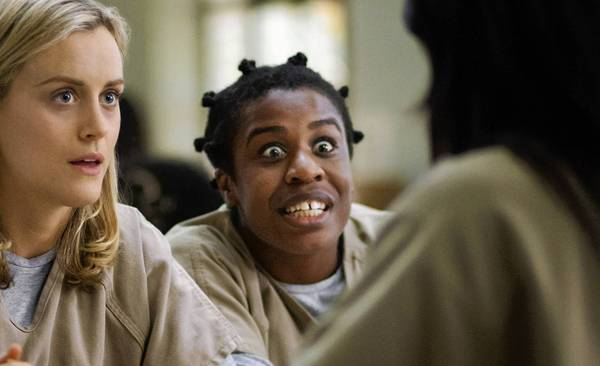 "(L-R) Taylor Schilling and Uzo Aduba as Crazy Eyes in ""Orange is the New Black"""