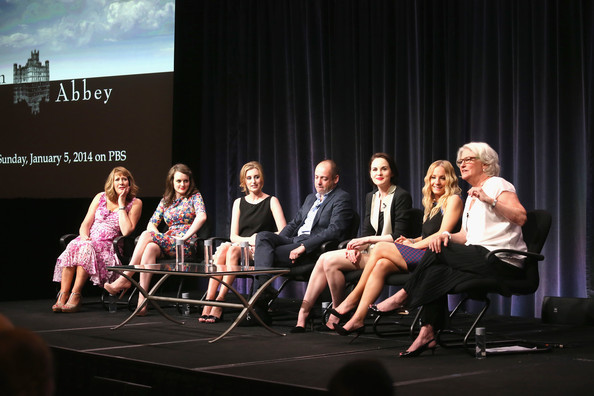"(L-R) Actors Phyllis Logan, Sophie McShera, Laura Carmichael, executive producer Gareth Neame, Michelle Dockery, Joanne Froggatt and series executive producer Rebecca Eaton speak onstage during the ""Downton Abbey"" panel at the PBS portion of the 2013 Summer Television Critics Association tour at the Beverly Hilton Hotel on August 6, 2013 in Beverly Hills"