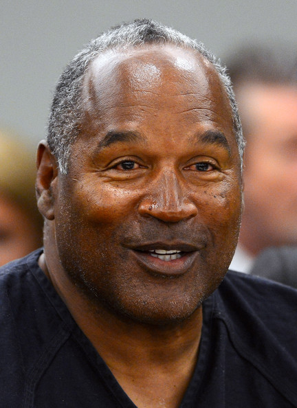 O.J. Simpson smiles during an evidentiary hearing in Clark County District Court on May 17, 2013 in Las Vegas