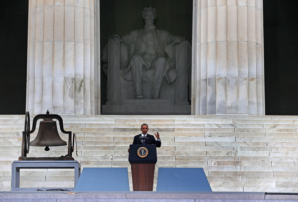 President Barack Obama speaks at the Lincoln Memorial, next to the bell from Birmingham's 16th Street Baptist Church during the ceremony to commemorate the 50th anniversary of the March on Washington for Jobs and Freedom August 28, 2013 in Washington, DC.