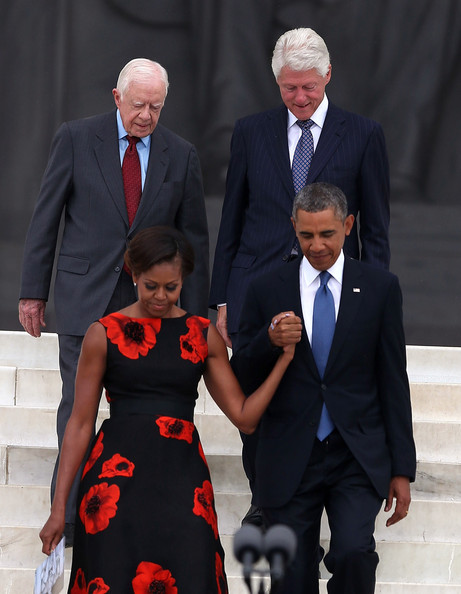President Barack Obama (R) walks with his wife Michelle Obama (2nd-L) and former Presidents Jimmy Carter (L) and Bill Clinton during the ceremony to commemorate the 50th anniversary of the March on Washington for Jobs and Freedom August 28, 2013 in Washington, DC