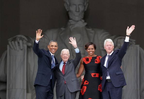(L-R) U.S. President Barack Obama, former president Jimmy Carter, first lady Michelle Obama, and former president Bill Clinton wave as they leave at the end of the Let Freedom Ring ceremony at the Lincoln Memorial August 28, 2013 in Washington, DC.