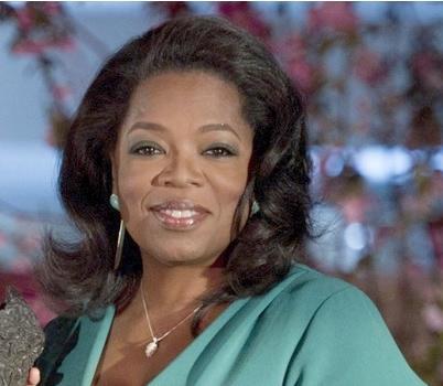 oprah (green top)