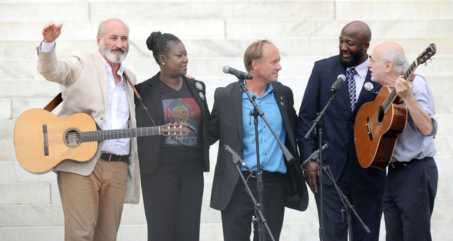 "Singers Peter Yarrow and Paul Stookey sing alongside with Trayvon Martin's parents, Tracy Martin and Sybrina Fulton, during the ""Let Freedom Ring"" ceremony to commemorate the 50th anniversary of the March on Washington for Jobs and Freedom at the Lincoln Memorial on the National Mall on August 28, 2013 in Washington, DC"