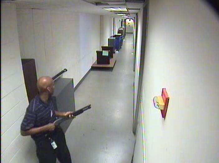 Aaron Alexis moves through the hallways of Building #197 carrying the Remington 870 shotgun.