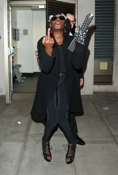 Grace Jones flips paps the bird on the way out of the Serpentine Summer Party in London. (June 26, 2013)
