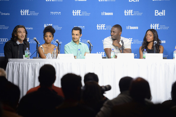 "(L-R) Director Justin Chadwick, actress Lindiwe Matshikiza, actor Riaad Moosa, actor Idris Elba and actress Naomie Harris speak onstage at ""Mandela: Long Walk To Freedom"" Press Conference during the 2013 Toronto International Film Festival at TIFF Bell Lightbox on September 8, 2013 in Toronto"