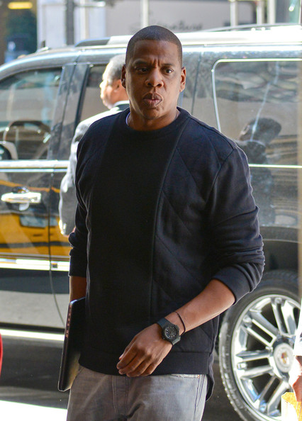 Jay Z arrives at an office building in New York City on September 18, 2013.