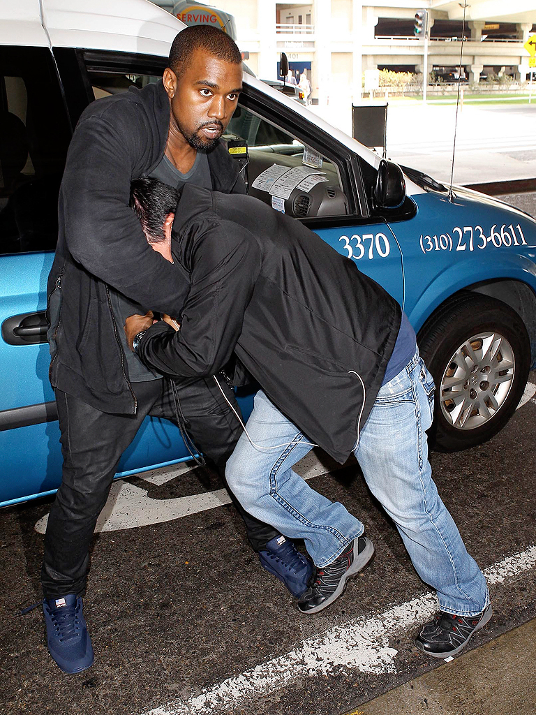 kanye-west-scuffles-with-pap768