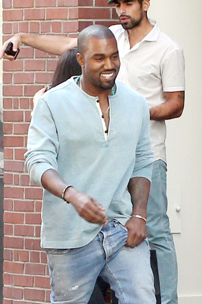 Kanye West is all smiles as he goes out and about in New York. (September 8, 2013)