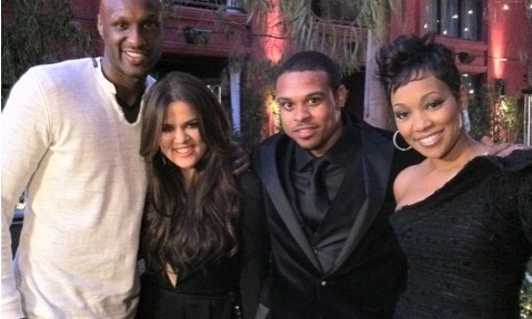 (L-R): Lamar Odom, his wife Khloe Kardashian, Shannon Brown, his wife Monica