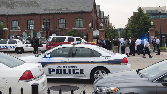 Police respond to the report of a shooting at the Navy Yard in Washington, DC, September 16, 2013.