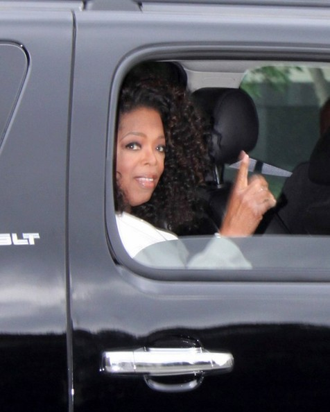 Talk show host Oprah Winfrey leaves her hotel and heads to the Martin Luther King Jr. celebration on August 28, 2013 in Washington D.C.