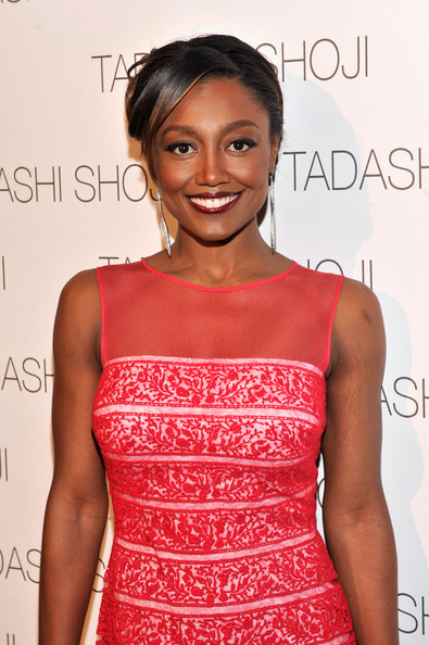 Actress Patina Miller prepares backstage at the Tadashi Shoji Spring 2014 fashion show during Mercedes-Benz Fashion Week at The Stage at Lincoln Center on September 5, 2013 in New York City