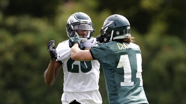 Philadelphia Eagles cornerback Carey Williams, left, and Riley Cooper push each other during practice at the NFL football team's training facility, Thursday, Sept. 5, 2013 in Philadelphia