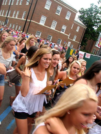 Squeals and screams rolled out of Bryant Denny Stadium along with the new sorority sisters as they ran to their respective houses along sorority row on Bid Day - Aug. 17, 2013