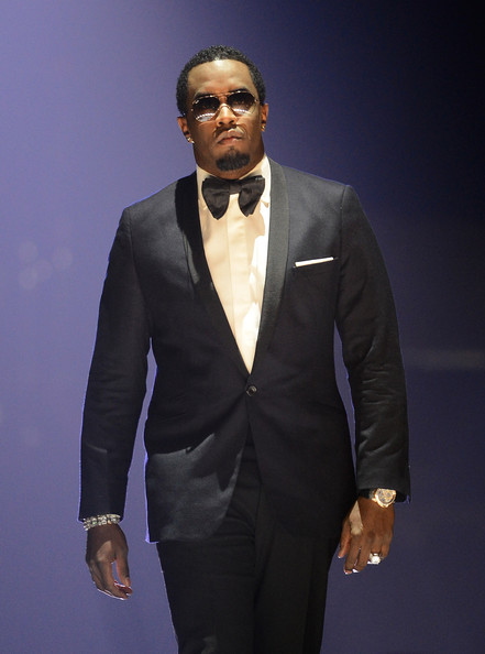 "Recording artist Sean ""Diddy"" Combs introduces a performance by Robin Thicke during the iHeartRadio Music Festival at the MGM Grand Garden Arena on September 20, 2013 in Las Vegas, Nevada"