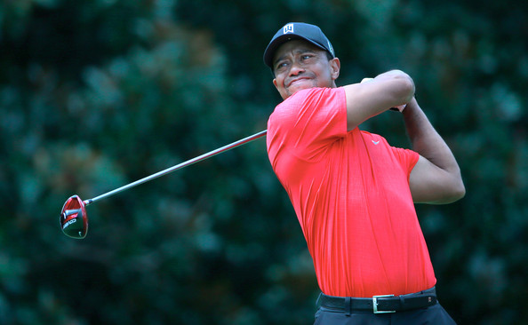 Tiger Woods watches his tee shot on the fifth hole during the final round of the TOUR Championship by Coca-Cola at East Lake Golf Club on September 22, 2013 in Atlanta, Georgia