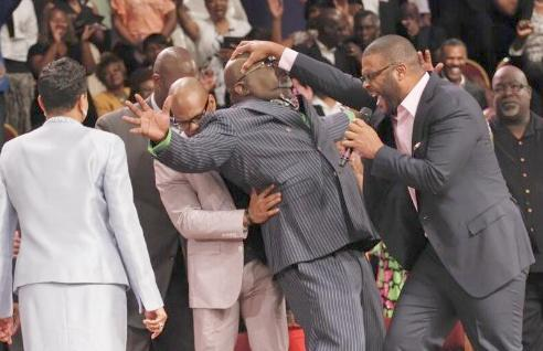 tyler perry laying hand on td jakes