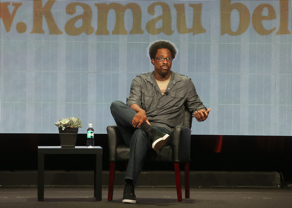 "Host/Comic W. Kamau Bell speaks onstage during the ""Totally Biased With W. Kamau Bell"" panel discussion at the FX portion of the 2013 Summer Television Critics Association tour - Day 10 at The Beverly Hilton Hotel on August 2, 2013 in Beverly Hills"