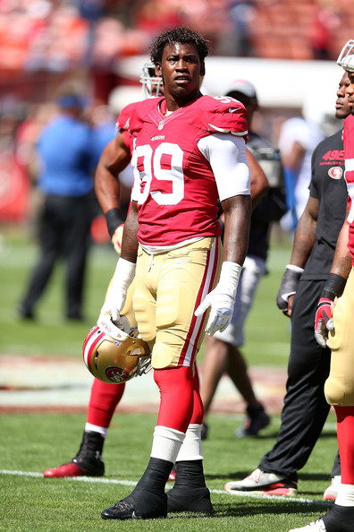 Aldon Smith #99 of the San Francisco 49ers looks on during warm-ups against the Indianapolis Colts at Candlestick Park on September 22, 2013 in San Francisco