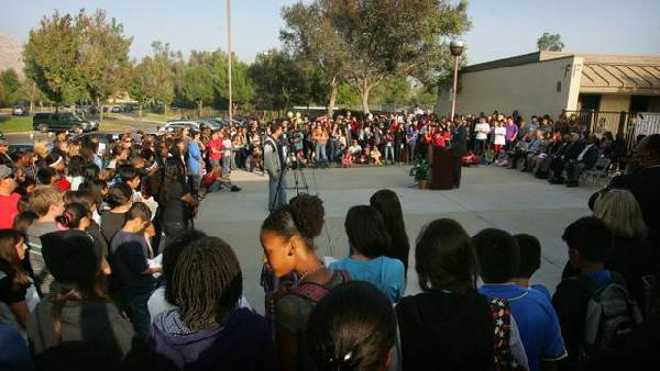 Students, family and teachers attend a vigil for young Elijah Allen. PHOTO BY DAVID BAUMAN/STAFF PHOTOGRAPHER