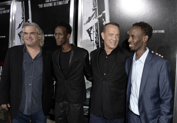 (L-R) Director Paul Greengrass, actors Mahat M. Ali, Tom Hanks, and Barkhad Abdi arrive at the premiere of Columbia Pictures' 'Captain Phillips' at the Academy of Motion Picture Arts and Sciences on September 30, 2013 in Beverly Hills