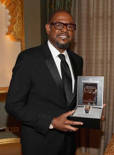 Actor Forest Whitaker poses with his lifetime achievement award presented by Jaeger LeCoultre at the opening ceremony of the Abu Dhabi Film Festival on Day 1 of the Abu Dhabi Film Festival 2013 on October 24, 2013 in Abu Dhabi, United Arab Emirates