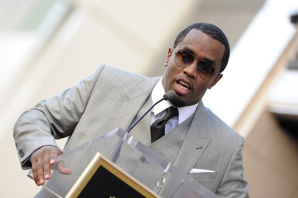 "Sean Combs speaks at the unveiling of Kenneth ""Babyface"" Edmonds' star on the Hollywood Walk of Fame on October 10, 2013"