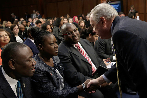 "Sybrina Fulton of Miami, Fla., mother of Trayvon Martin, greets Sen. Richard Durbin (D-IL) during a Senate Judiciary Committee hearing on ""Stand Your Ground"" laws October 29, 2013 in Washington, DC."