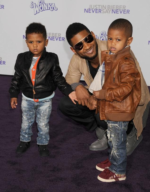 Usher with his two sons with Foster, Usher Raymond V (right) - who is nicknamed Cinco, and Naviyd Ely Raymond (left).