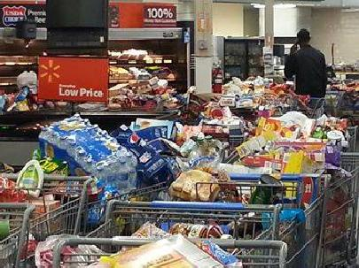 walmart carts piled up with items