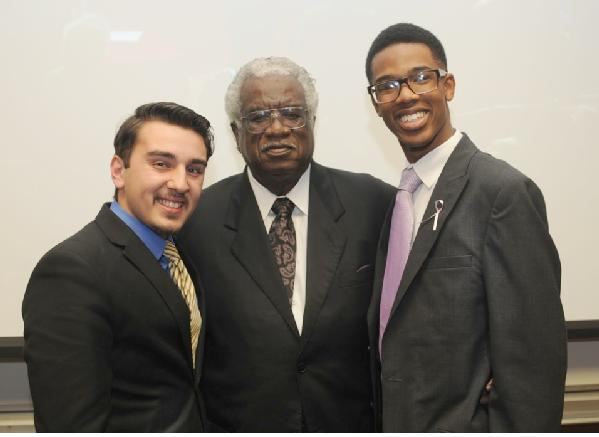 wiley college debaters and wiley college president and CEO Dr. Haywood L. Strickland (center)