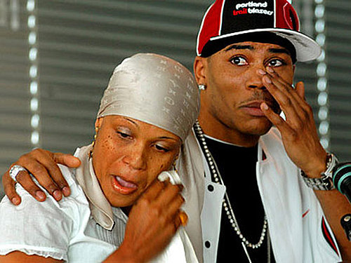Nelly with his sister, Jacqueline Donahue, at a press conference before her passing