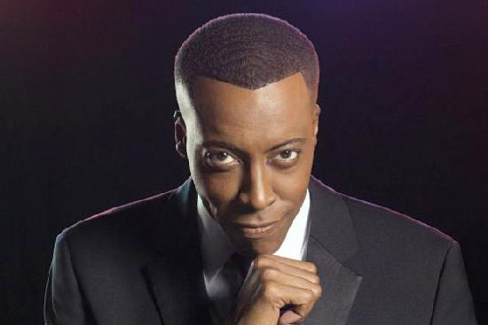 arsenio hall (fist under chin)