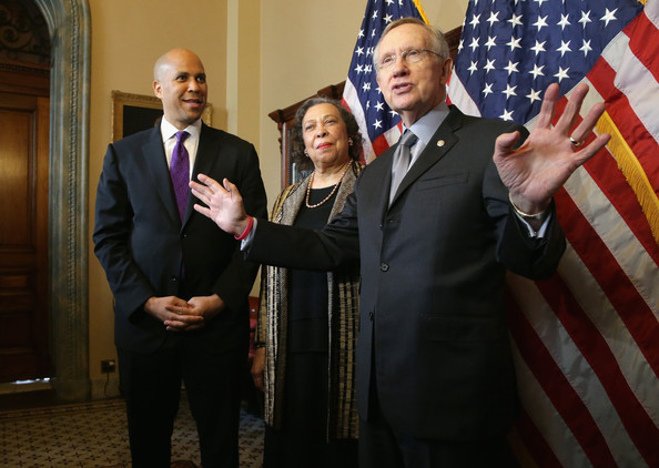 Senate Majority Leader Harry Reid (D-NV) (R) meets with former Newark, New Jersey Mayor Cory Booker (L) and his mother Carolyn Booker prior to Cory Booker's swearing in as U.S. Senator October 31, 2013 in Washington, DC.