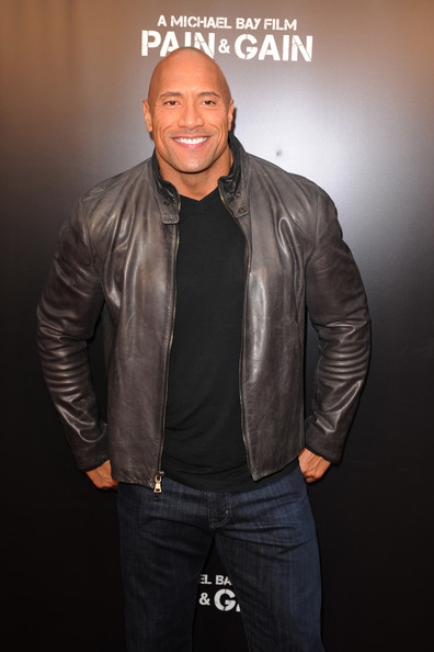 """Dwayne Johnson attends the """"Pain & Gain"""" premiere on April 11, 2013 in Miami Beach, Florida"""