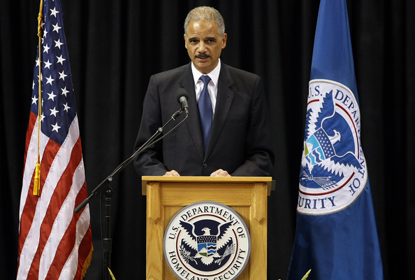 Attorney General Eric Holder speaks during a memorial service for slain LAX Transportation Security Administration Officer Gerardo Hernandez at the Los Angeles Sports Arena on November 12, 2013 in Los Angeles