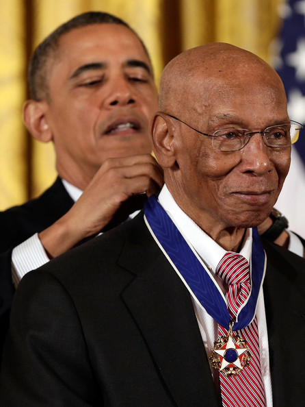 President Barack Obama awards the Presidential Medal of Freedom to Hall of Fame baseball player Ernie Banks in the East Room at the White House on November 20, 2013 in Washington, DC