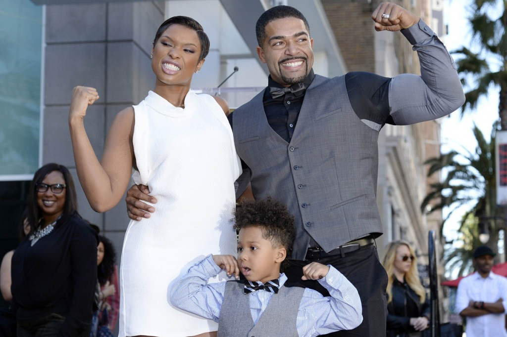 Jennifer Hudson, her fiance David Otunga and their son David Jr., pose on her star after it was unveiled on the Walk of Fame in Hollywood, California November 13, 2013.