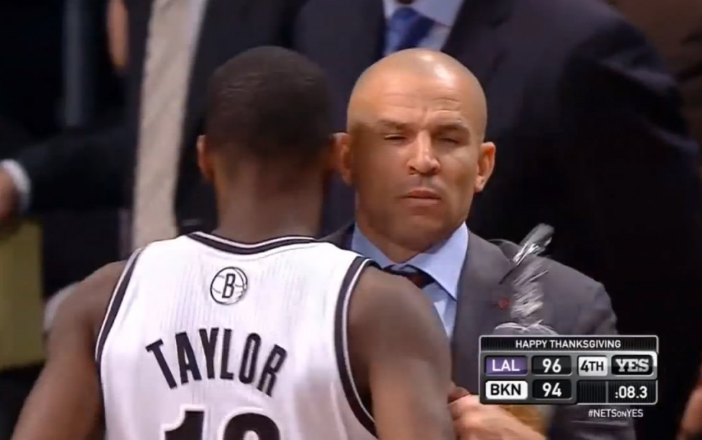 Real or staged? Taylor bumps into his coach Jason Kidd, causing his soda to spill