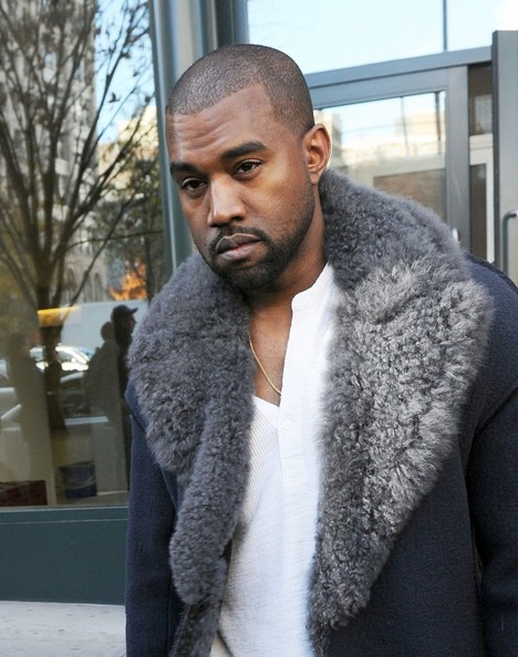 Rapper Kanye West leaves his apartment on November 20, 2013 in New York City, New York