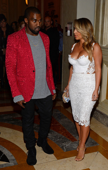 Rapper Kanye West (L) and television personality Kim Kardashian arrive at the Tao Nightclub at The Venetian Las Vegas to celebrate Kardashian's 33rd birthday on October 26, 2013 in Las Vegas